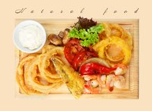 Restaurant food - roasted seafood with grilled vegetables assort Stock Image