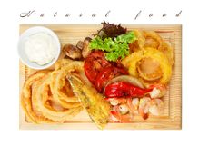 Restaurant food - roasted seafood with grilled vegetables assort Royalty Free Stock Photography