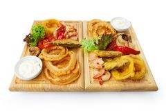 Restaurant food - roasted seafood with grilled vegetables assort Royalty Free Stock Photos