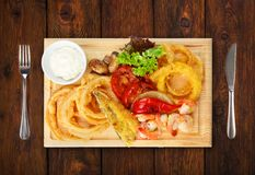 Restaurant food - roasted seafood with grilled vegetables assort Royalty Free Stock Photo
