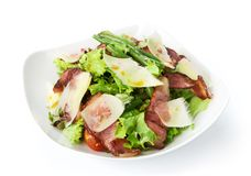 Restaurant food - salad with fried bacon and parmesan Royalty Free Stock Image