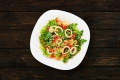 Restaurant food - seafood salad with calamari Royalty Free Stock Photo