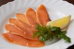 Restaurant food. Sliced salmon with lemon Stock Images