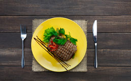 Restaurant food top view on wooden table. Perfect beef steak royalty free stock photo