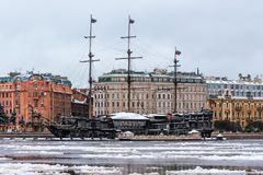 The restaurant in the form of a sailing ship is moored to the banks of the Neva near the Peter and Paul Fortress winter. Stock Photography