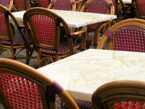 Restaurant in France. Details of chairs and tables outside a restaurant in France Stock Photos