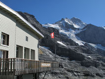 Restaurant in front of Jungfrau summit. Restaurant with swiss flag in front of Jungfrau summit stock photography