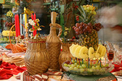 Restaurant. And fruits on a plate pineapple and grapes Stock Photography