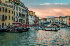 Restaurant and gondolas near the Rialto Bridge in Venice Stock Photos