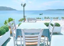 The restaurant on the Greek island. Restaurant overlooking the azure sea Royalty Free Stock Photos