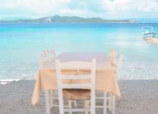 Restaurant on the Greek island. Restaurant overlooking the azure sea Stock Photography