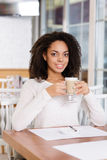 Restaurant guest is drinking coffee Stock Image