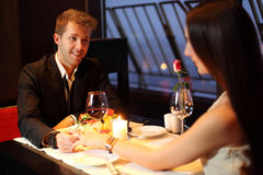 The restaurant guy holding Brunette by hand Royalty Free Stock Photos