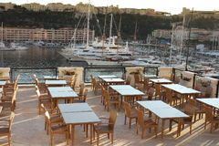 Restaurant at the harbor of monaco Stock Images