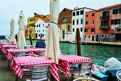 Restaurant and historical buildings, in Venice, Italy Royalty Free Stock Photos