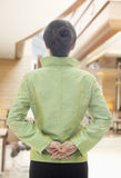 Restaurant/Hotel Hostess in Traditional Chinese Clothing and Hands Behind Back, View From Behind Royalty Free Stock Image