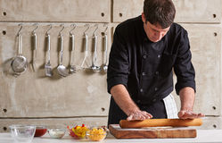 Restaurant hotel private chef preparing pizza rolling flattening Royalty Free Stock Images