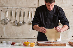 Restaurant hotel private chef preparing pizza rolling flattening Royalty Free Stock Photography