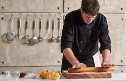 Restaurant hotel private chef preparing pizza rolling flattening Stock Photos