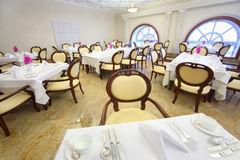 Restaurant in Hotel Ukraine. MOSCOW - APRIL 27: Restaurant in Hotel Ukraine, on April 27, 2011 in Moscow, Russia. This hotel is second highest Stalinsky Stock Images