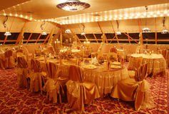 Restaurant interior. Luxury restaurant  gold colored interior Royalty Free Stock Photo