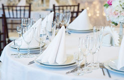 Restaurant interior for banquet, wedding. Glass, napkins and cutlery.  Table appointments, laying Stock Images