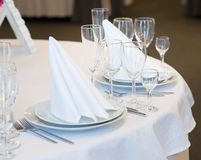 Restaurant interior for banquet, wedding. Glass, napkins and cutlery.  Table appointments, laying Stock Photo