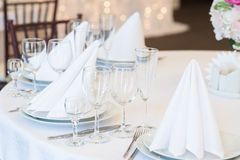 Restaurant interior for banquet, wedding. Glass, napkins and cutlery.  Table appointments, laying Royalty Free Stock Photos