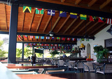 Restaurant interior with flags Stock Photos