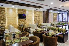 Restaurant interior. Modern restaurant interior with tables and sofas Stock Photo