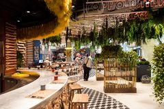 Restaurant interior in new Zaryadye Park, urban park located near Red Square in Moscow, Russia. Moscow, Russia - September, 2017: Restaurant interior in new Royalty Free Stock Photo