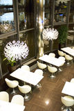 Restaurant interior at night. White and modern ambient Royalty Free Stock Image