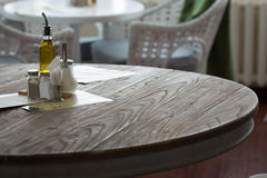Restaurant interior. Pepper and salt on the table. Restaurant interior. Pepper, salt olive oil sugar napkins and toothpicks on the table stock photography