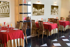 Restaurant interior with red&beige tablecloths. Restaurant interior, photographs at walls are author's, inserted in photoshop royalty free stock photos