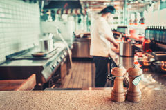 Restaurant interior with salt and pepper Stock Images