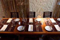 Restaurant interior with served table. Served wooden restaurant table in interior Stock Images