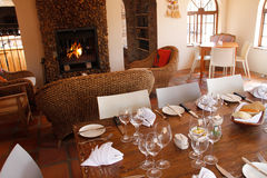 Restaurant interior with set table and fireplace Stock Photos