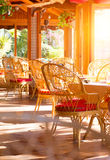 Restaurant interior. Summer coffee terrace with tables and wicker chairs Royalty Free Stock Photos