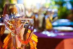 Restaurant interior with wine glasses, closeup. Bright blurred background. evening time. soft focus, copy space Royalty Free Stock Photography