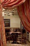 Restaurant interrior. Vintage spanish restaurant entrance doorway with red curtain stock photos