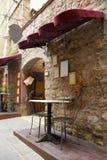 Restaurant in Italy, Tuscany. Sidewalk restaurant in Italy, Tuscany Royalty Free Stock Image
