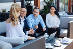 Joyful friendly colleagues meeting together Royalty Free Stock Photography