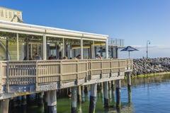Restaurant and kiosk in Melbourne. Melbourne, Australia - September 10, 2015: People dining in restaurant and kiosk in St Kilda Pier, Melbourne. The kiosk was Stock Photos
