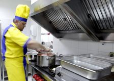 In a restaurant kitchen. A cook is stirring a dish in a restaurant kitchen Stock Photo
