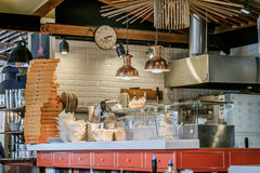 Restaurant kitchen with a huge pile of pizza boxes. Restaurant kitchen with a huge pile of pizza  boxes Royalty Free Stock Image