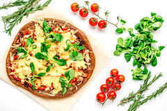 Restaurant kitchen with pizza preparing on white background top view Royalty Free Stock Photo