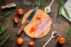 Restaurant kitchen with steak preparing on wooden background top view. Restaurant kitchen with raw steak preparing on wooden background top view Stock Photos