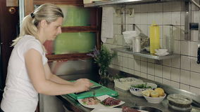 Restaurant kitchen woman preparing fish dishes for guests. stock video footage