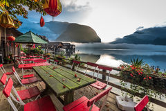 Restaurant on the lake at dawn in the Alps Royalty Free Stock Image