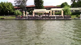 Restaurant on the lake. Restaurant seen from the boat on the lake stock video footage